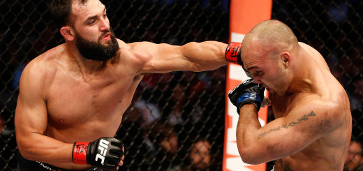 DALLAS, TX - MARCH 15:  (L-R) Johny Hendricks punches Robbie Lawler in their UFC welterweight championship bout at UFC 171 inside American Airlines Center on March 15, 2014 in Dallas, Texas. (Photo by Josh Hedges/Zuffa LLC/Zuffa LLC via Getty Images)