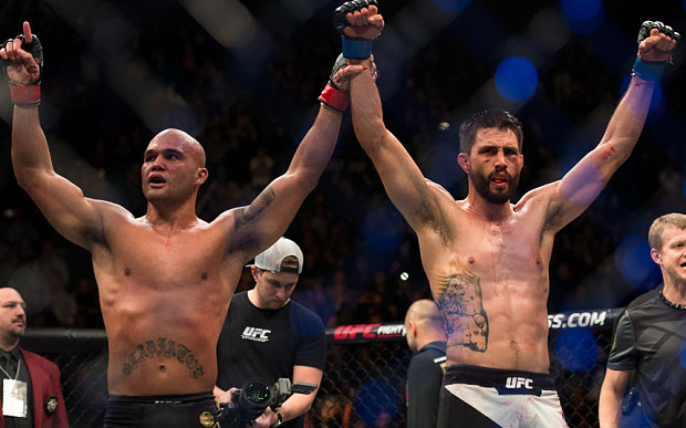 After throwing down for 25 minutes, Carlos Condit and Robbie Lawler acknowledged the raucous crowd that was on its feet.