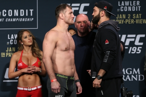 For the co-main event, most books have Stipe Miocic as a -210 favorite vs. Andrei Arlovski in crucial heavyweight scrap. Also pictured: Octagon Gal Brittney Palmer.