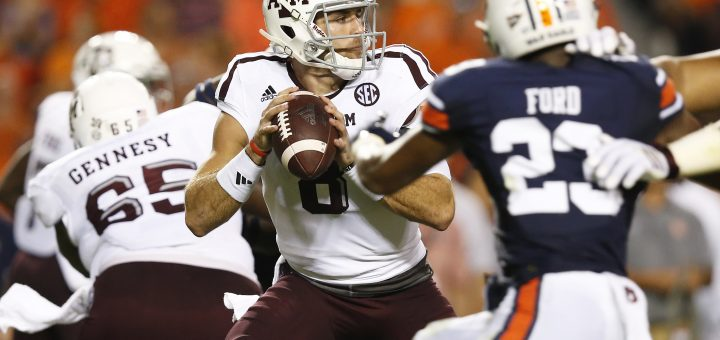 Texas A&M quarterback Trevor Knight, center, sets back to pass the ball against Auburn in the first half during an NCAA college football game, Saturday, Sept. 17, 2016, in Auburn, Ala. (AP Photo/Brynn Anderson)